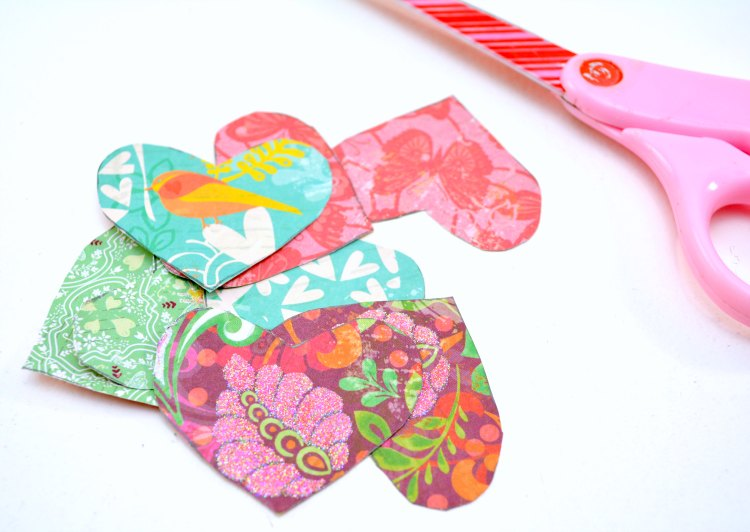 hearts cut out of scrap book paper ready for a craft project for Valentine's Day