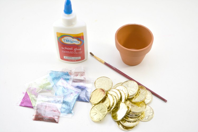 Supplies for creating a set of rainbow glittered ceramic pots of gold