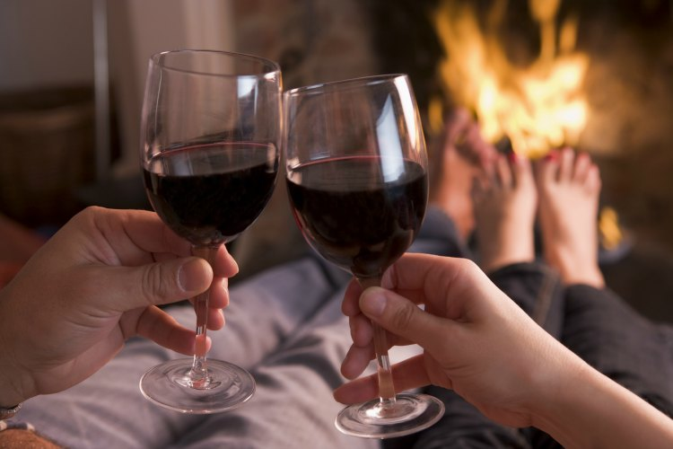 Valentine's Day ideas - having wine by the fire place