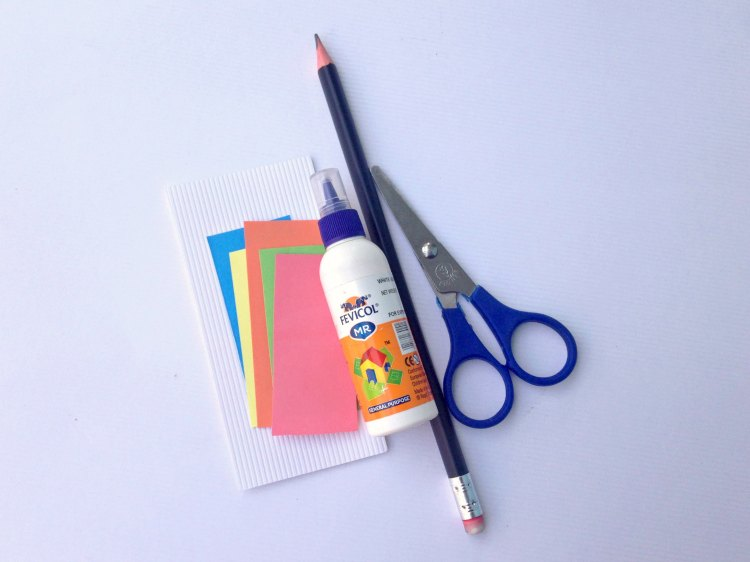 card stock, glue, pencil, scissors for making an Easter craft project