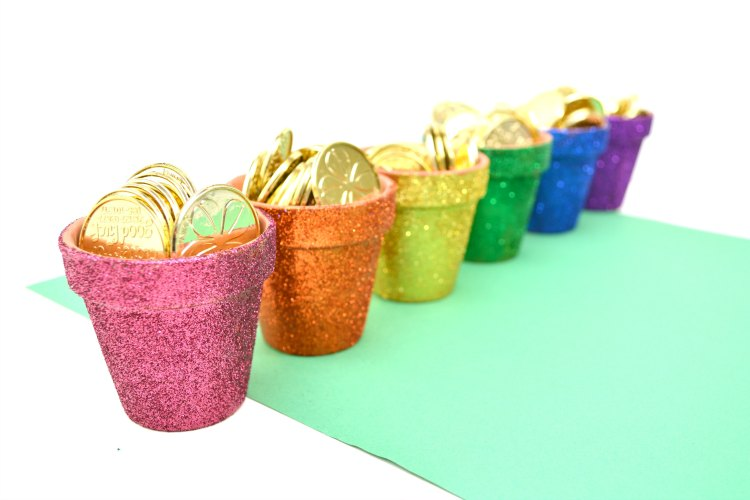 mini pots of gold in rainbow colors for St. Patrick's Day