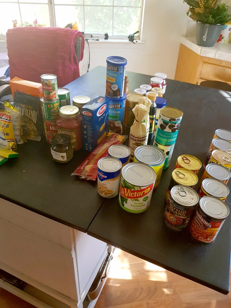 pantry staples on the kitchen island for organizing