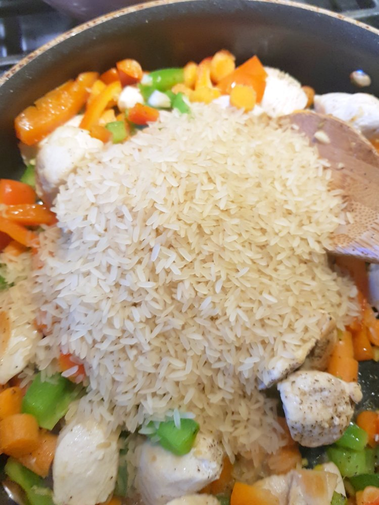Added rice to stir fried chicken, and vegetables See full recipe at DearCreatives.com