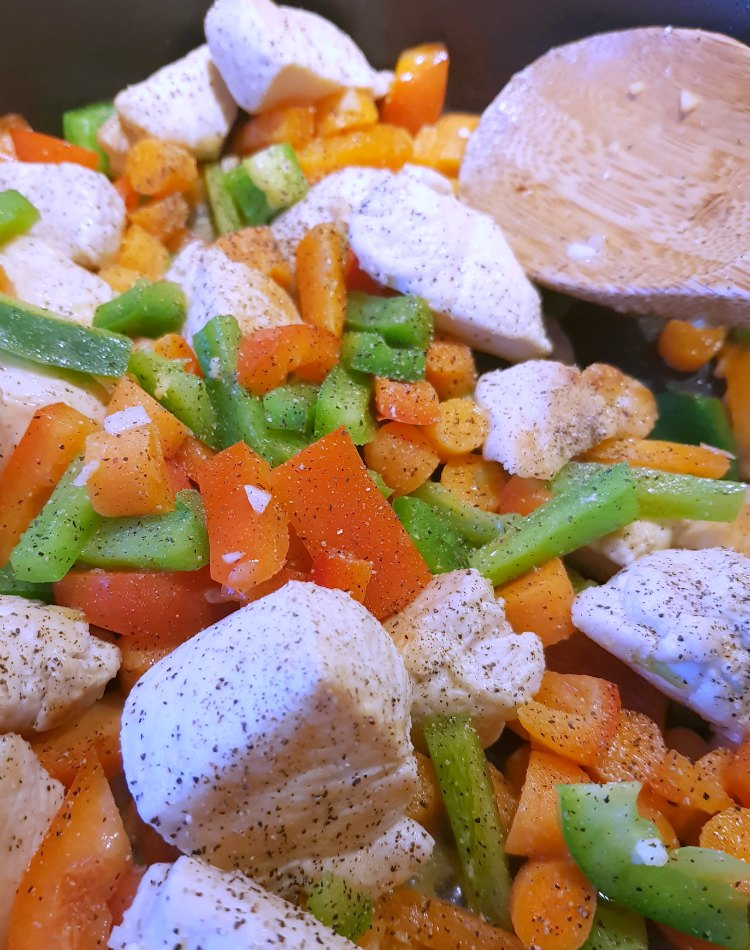 Stir fried chicken and vegetables with pepper added for chicken stir fried rice See Recipe at DearCreatives.com