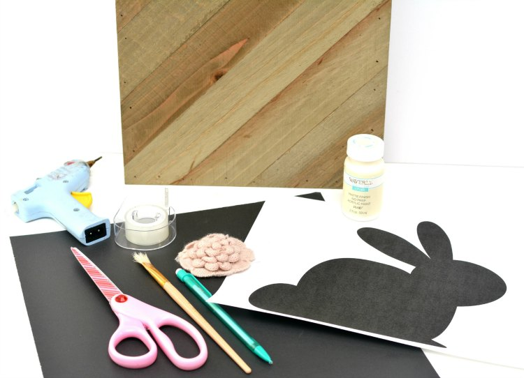 craft supplies for painted wood bunny craft. Wood, scissors, paper, paint, tape, pen, paintbrush. DIY with bunny template at DearCreatives.com