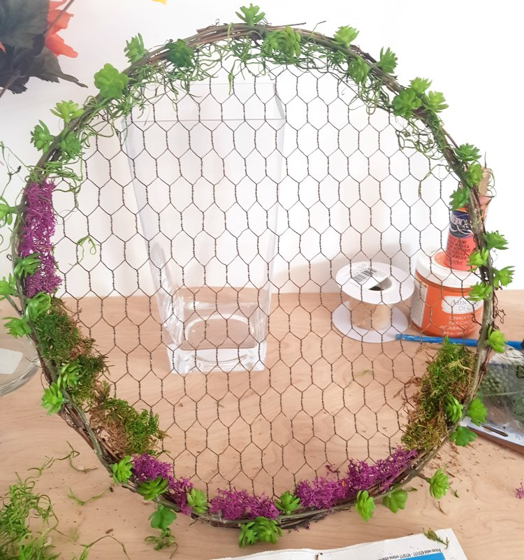 Adding moss to the succulent wrath. See this wreath idea, and diy wreath at DearCreatives.com