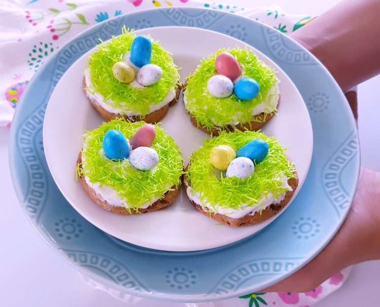 Holding a plate of decorated Easter Cookies that are so easy to make. This will make you love decorating Easter cookies, it's a no fail easy recipe. Grab it at DearCreatives.com