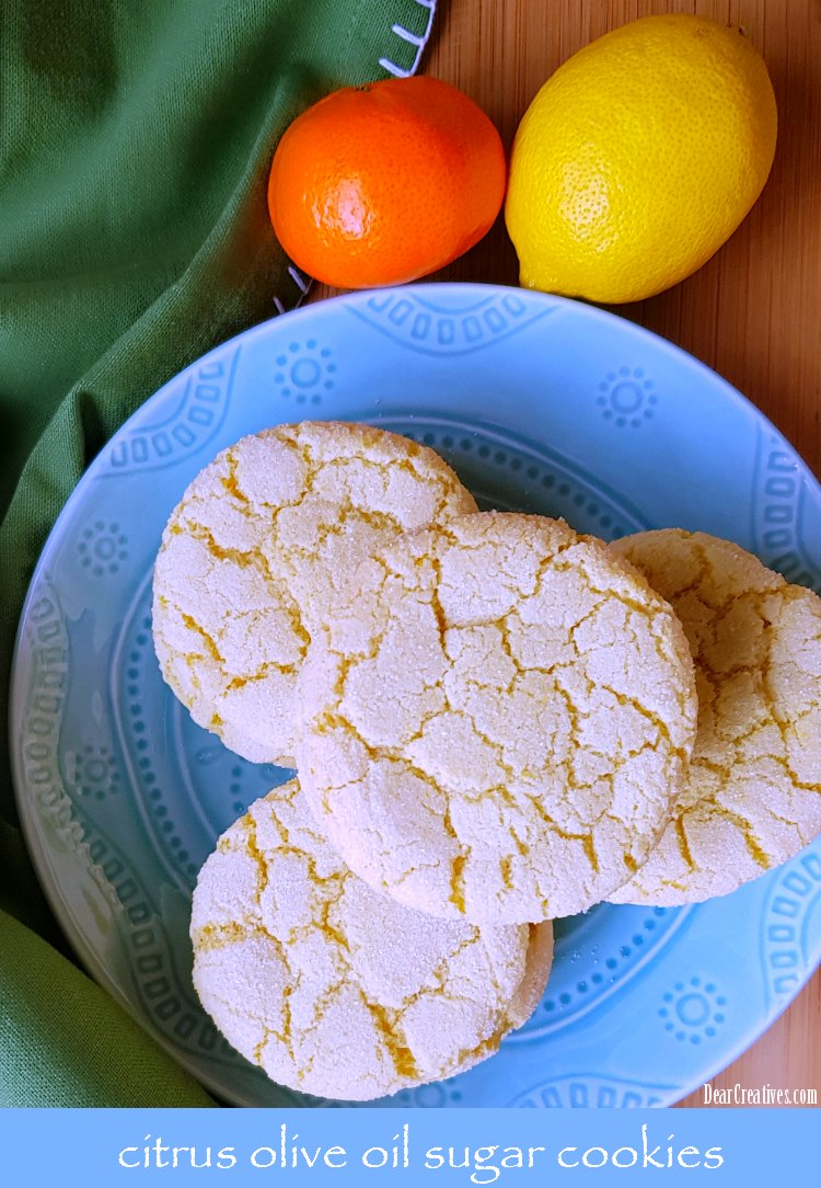 You'll love making this easy sugar cookies recipe. It uses olive oil, and grated citrus. They are divine! You have to try making a batch now! Grab the olive oil sugar cookies recipe at DearCreatives.com #sugarcookies #cookies #oliveoilsugarcookies #lemonsugarcookies #flavoryourlife #momsmeet #sponsored