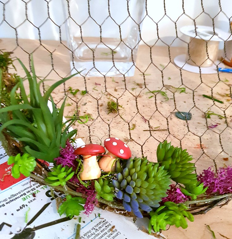 adding succulents, and accent embellishments to the spring-summer wreath. Full wreath tutorials at DearCreatives.com