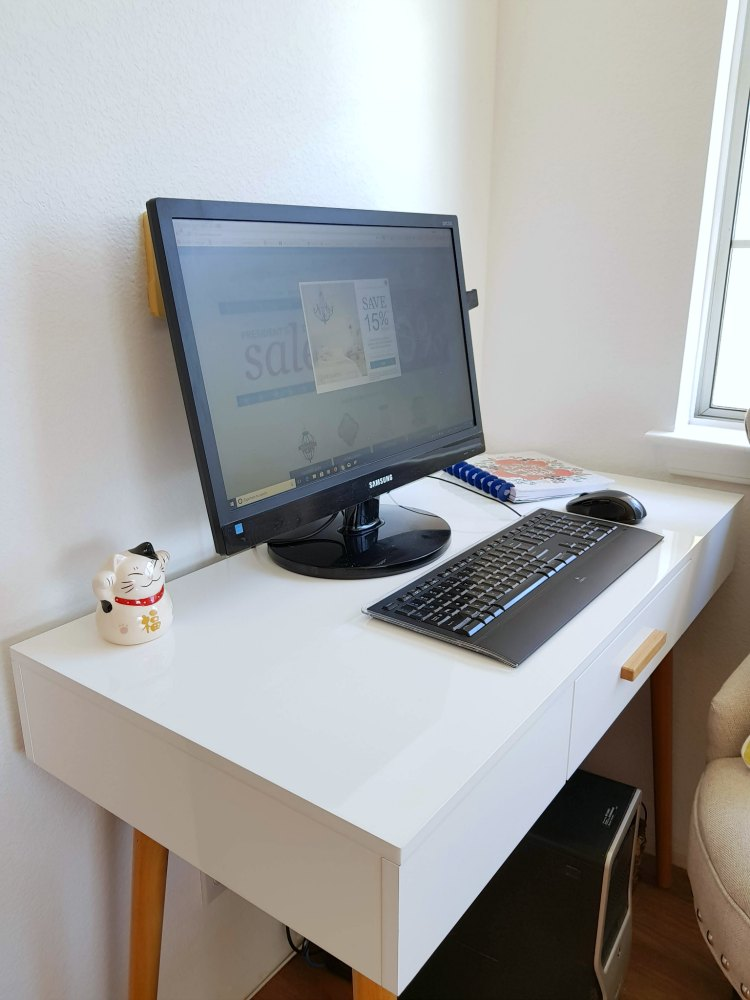 close up of Oslo desk Convenience Concepts Oslo White Computer Desk with Drawer on BellaCor in our home update © 2018 Theresa Huse DearCreatives.com