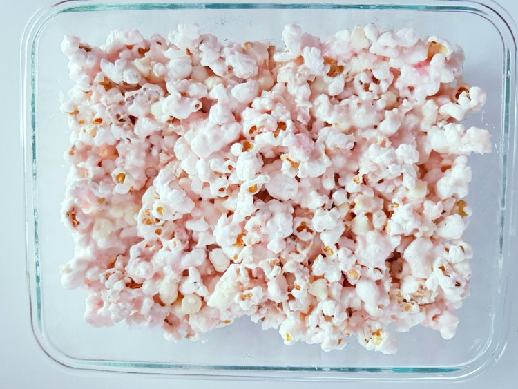 marshmallow coated popcorn for a popcorn bars treat. DearCreatives.com