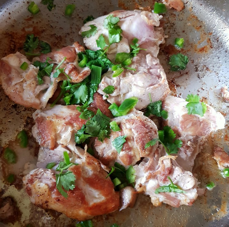 Next adding cilantro, and jalapeno to chicken for the easy chicken recipe