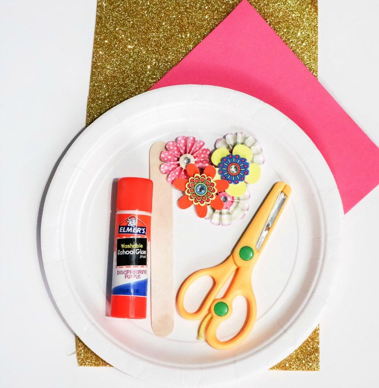Paper Plate, large Popsicle Stick, Paper Flowers, Craft Paper, Scissors for a unicorn kids craft project. DearCreatives.com