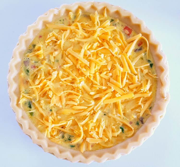 cheese quiche ready to be baked in the oven © DearCreatives.com