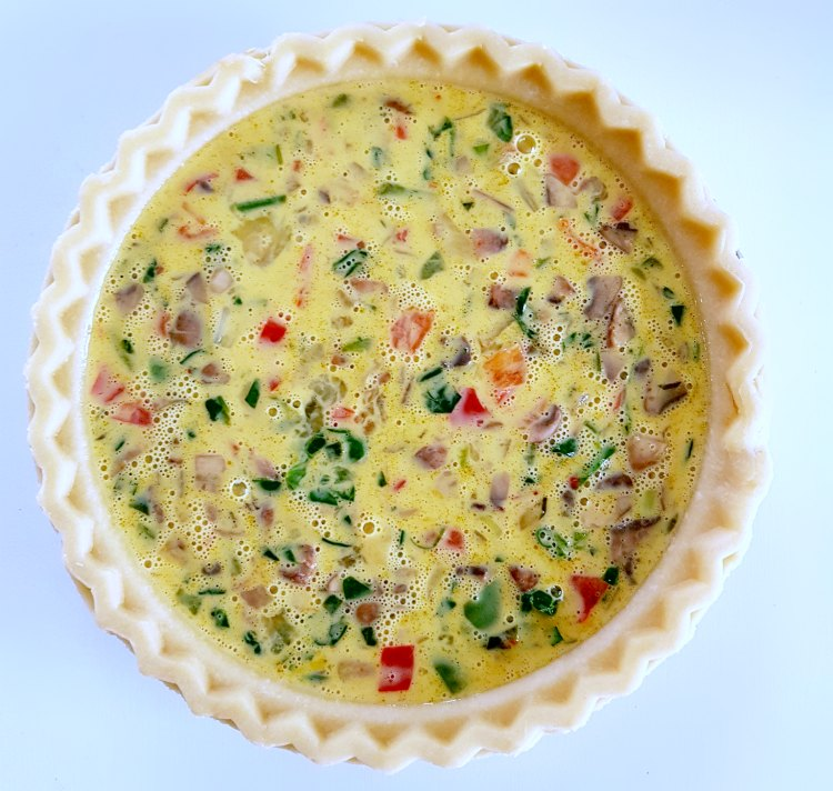 pie shell with unbaked quiche ready to be baked DearCreatives.com