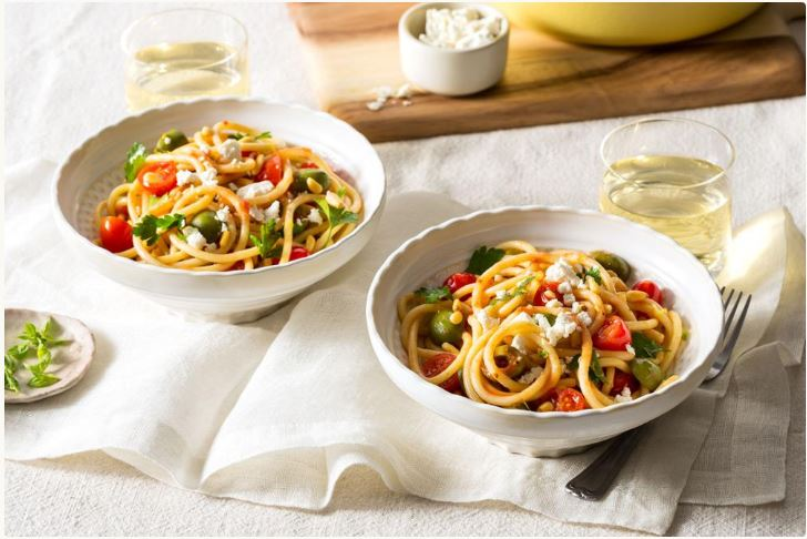 vegetarian pasta dish bucatini pomodoro with olives and...