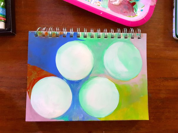 art journal with colorful art with circles. DearCreatives.com acrylic paints Do you want to get more creative See how to set up creative time. Tips for journals, art journals, and making time for art. DearCreatives.com #derwentacademy #IC #ad #journals #artjournals #art