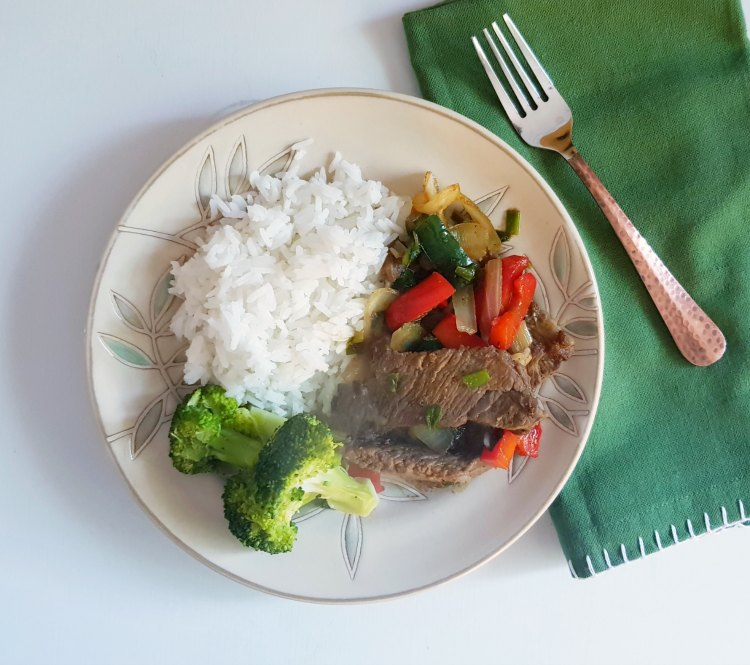 Beef stir fry just plated and ready to eat. Grab the beef stir fry recipe at DearCreatives.com