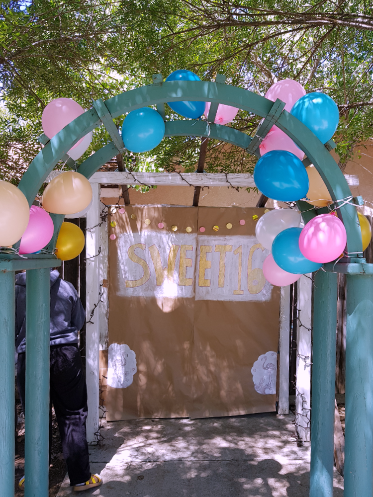 Photo Booth Props - arch with balloons, back drop with sweet 16, and decorations. Table to side for photo props, DIY at DearCreatives.com © 2018 DearCreatives.com