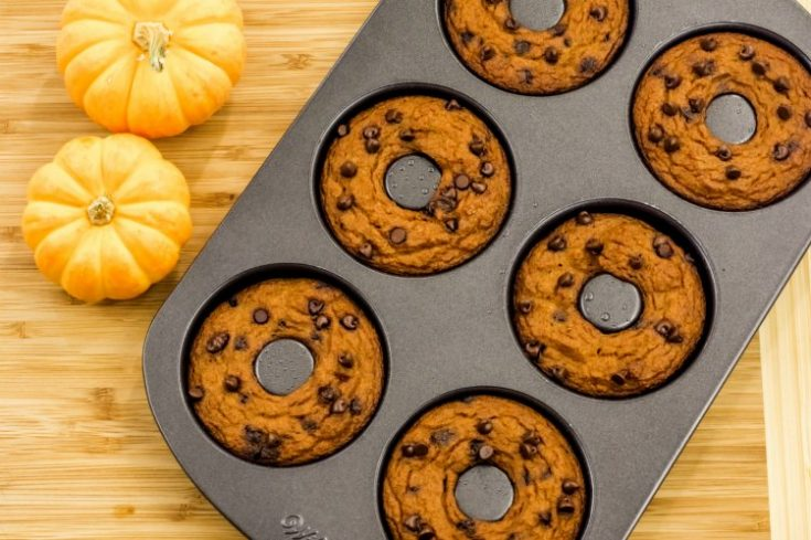 Pumpkin Chocolate Chip donuts in a pan. Recipe at DearCreatives.com