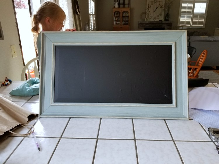 Start diy chalkboard sign by adding peel and stick chalkboard to your glass or wood frame. See finished diy and tips for chalkboard art for at DearCreatives.com