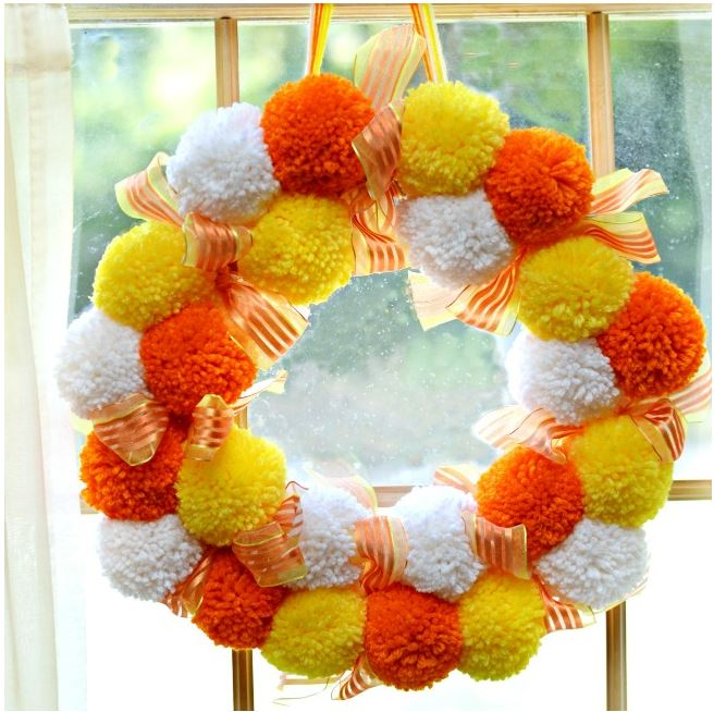 pom pom candy corn wreath diy via littlemisscelebration