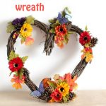 Heart Grapevine Wreath decorated for fall. You will want to make this quick and easy wreath plus door wreaths and grapevine wreath ideas at DearCreatives.com