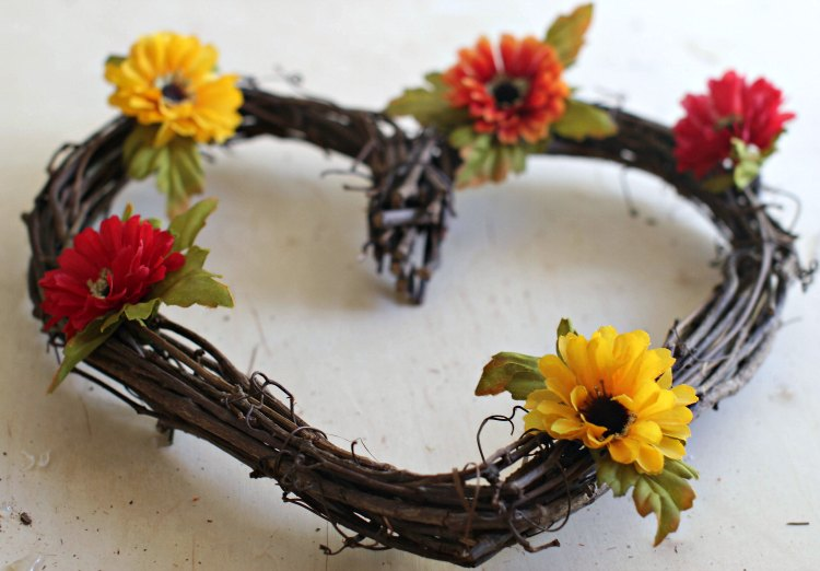 fall flowers hot glued to the grapevine wreath see full tutorial how to make a fall wreath at DearCreatives.com
