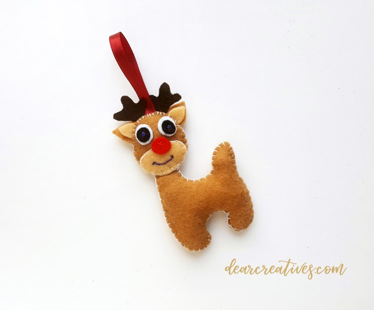 step (15) after head and neck are stitched together make a tiny knot....See full diy felt reindeer ornament at DearCreatives.com