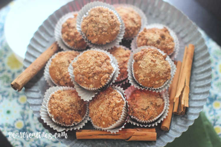 Ginger Pear Muffins- ginger muffins on a serving dish with cinnamon sticks. Grab the muffins recipe at Dearcreatives.com
