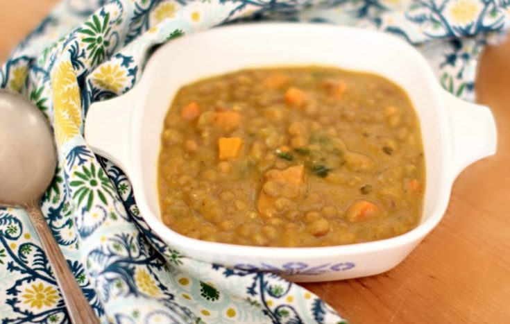 lentil soup in a bowl with a pretty cloth napkin and soup spoon. Lentil Soup Recipe at DearCreatives.com