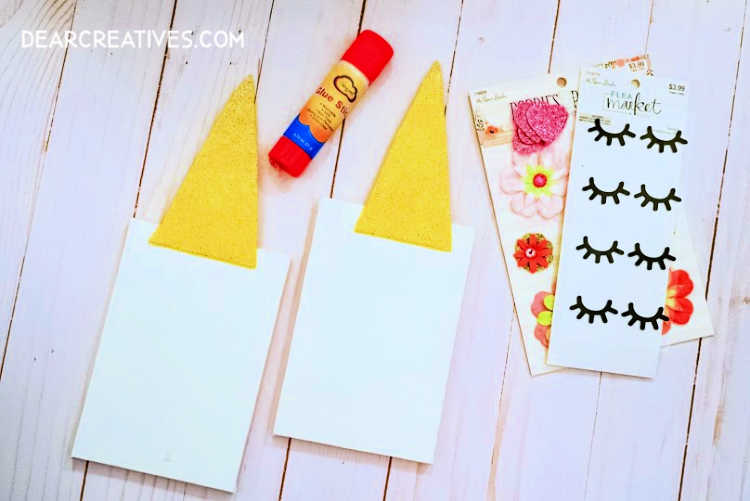 Step 2. Glue the gold glitter unicorn horn onto your mini canvas. See full unicorn diy at DearCreatives.com