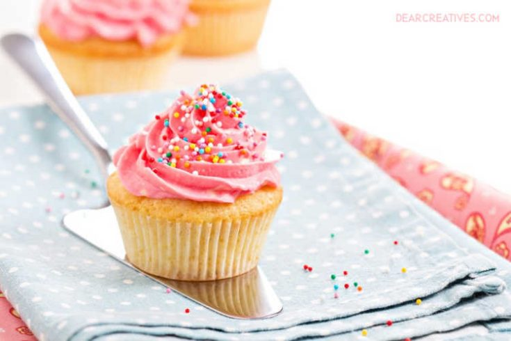Cupcakes with pink frosting and colorful sprinkles