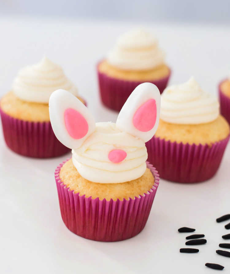 Starting to decorate the bunny face on the Easter cupcakes full directions and tutorial at DearCreatives.com