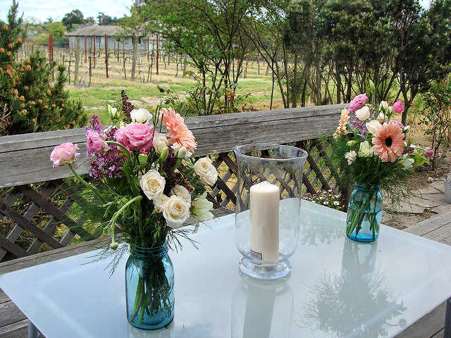 wedding flowers in mason jars days before the wedding to allow blooms to open DearCreatives.com © Theresa Huse