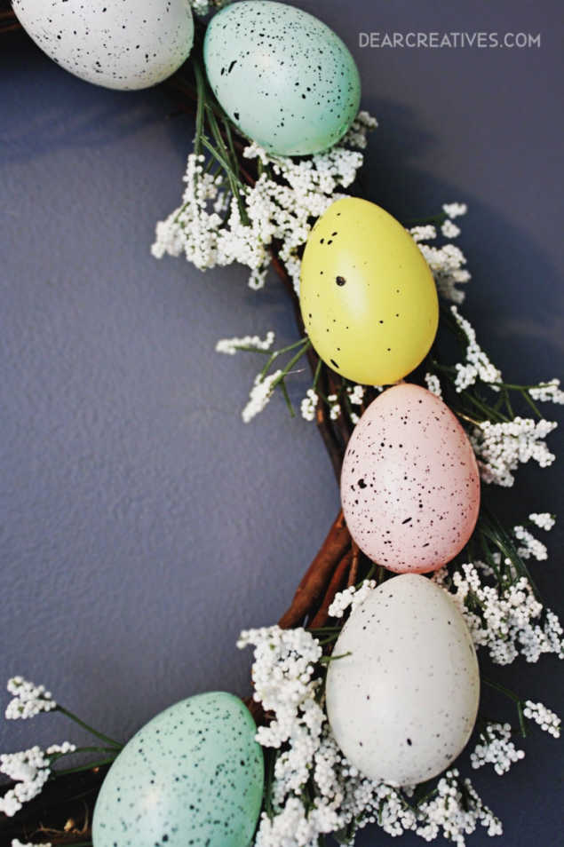 Easter Egg Wreath - Close up of faux eggs on a grapevine wreath with white flowers. DIY wreath at DearCreatives.com