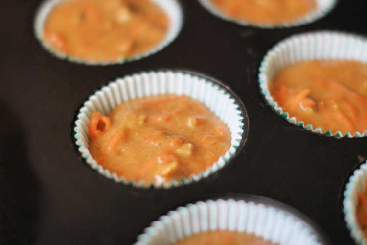 carrot cake cupcakes in a cupcake pan ready to be baked. Recipe at DearCreatives.com