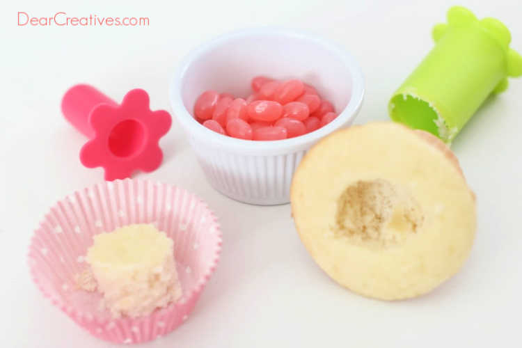 Coring out the center of the cupcake to be able to insert the jelly beans - DIY jelly bean cupcakes at DearCreatives.com