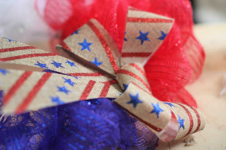 Adding a patriotic bow to the red, white