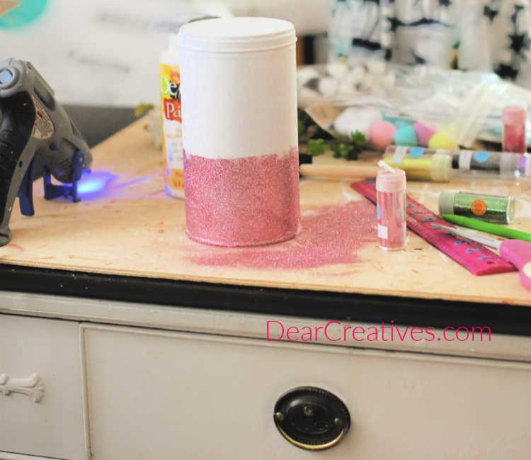 Glittering a can for unicorn room decor for a girls room. Girly unicorn decor instructions and unicorn ideas at DearCreatives.com