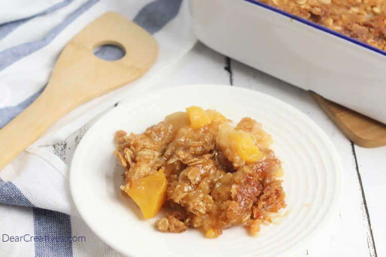 Peach Dump Cake - Close up of the peach dump cake before adding ice cream or whipped topping for the dessert. Grab this easy peach cake recipe now! You will love it! DearCreatives.com