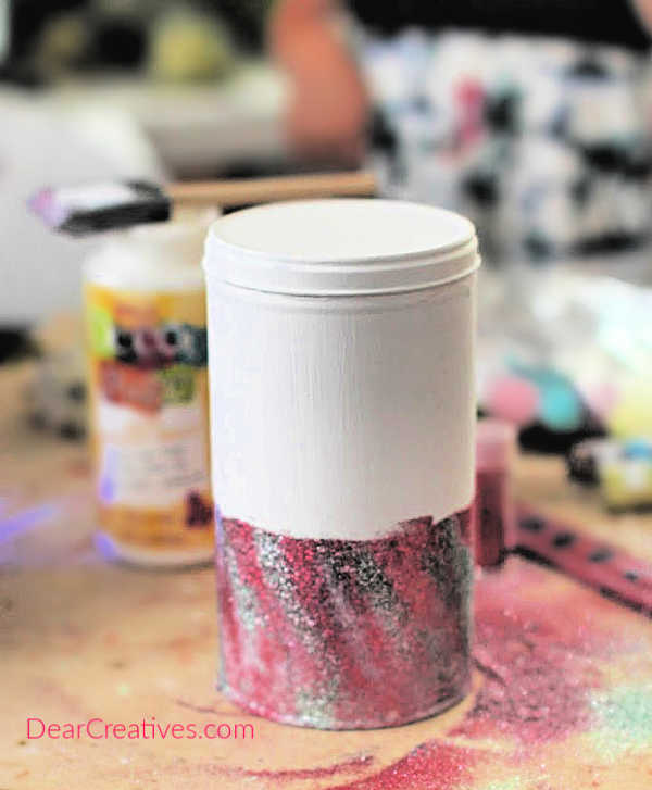 Second layer of glitter on can for unicorn room decor. See all steps and finished unicorn decor at DearCreatives.com