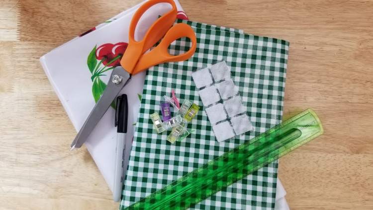 oilcloth fabric, sewing scissors, ruler, Velcro, thread...Supplies for making an oilcloth bag. DearCreatives.com