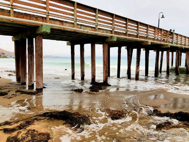 Walking on the beach - photo of the pier and ocean water in Cayucus, California DearCreatives.com