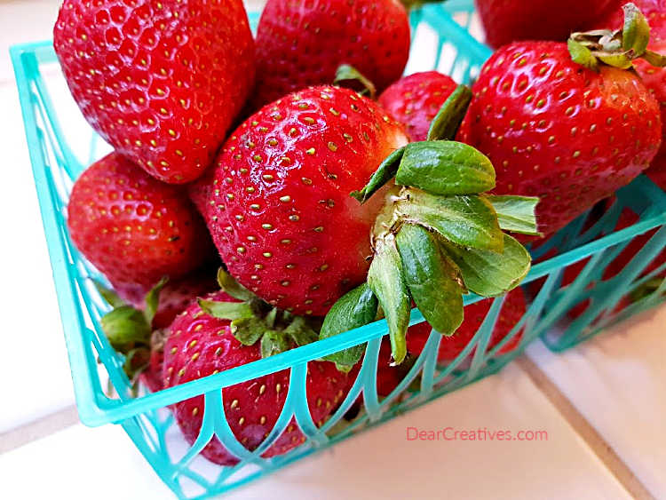 Fresh baskets of strawberries for making a cake with strawberries. Cake recipe at DearCreatives.com