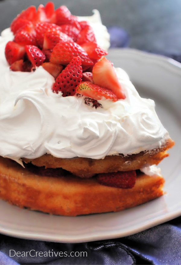 Strawberry Cake - Delicious, easy to make two-layer cake topped with whip cream and strawberries. Grab the cake at DearCreatives.com