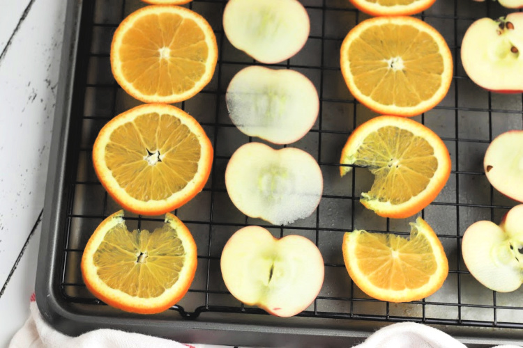Drying apples and oranges on a wire rack and sheet pan for making a simmering pot recipe - DearCreatives.com