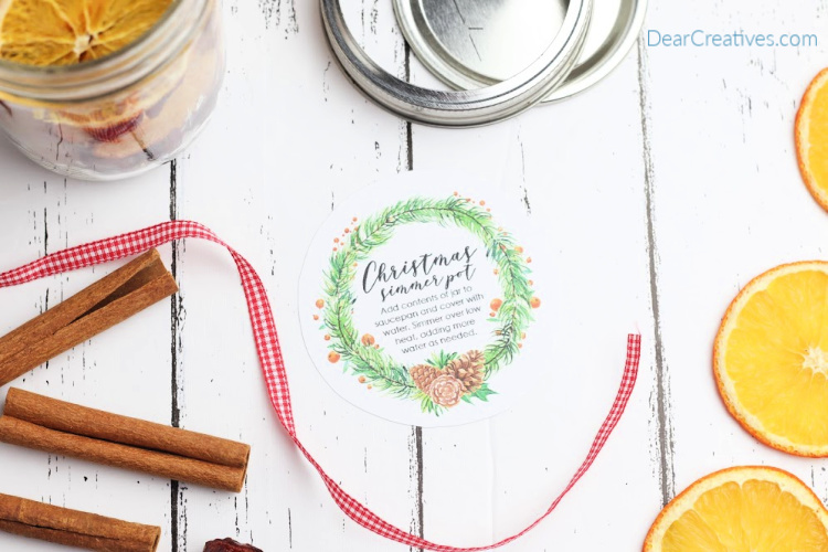 Mason jar, mason jar lid, cinnamon sticks, oranges,printable label, potpourri, ribbon for making a simmering pot gift in a jar. DearCreatives.com