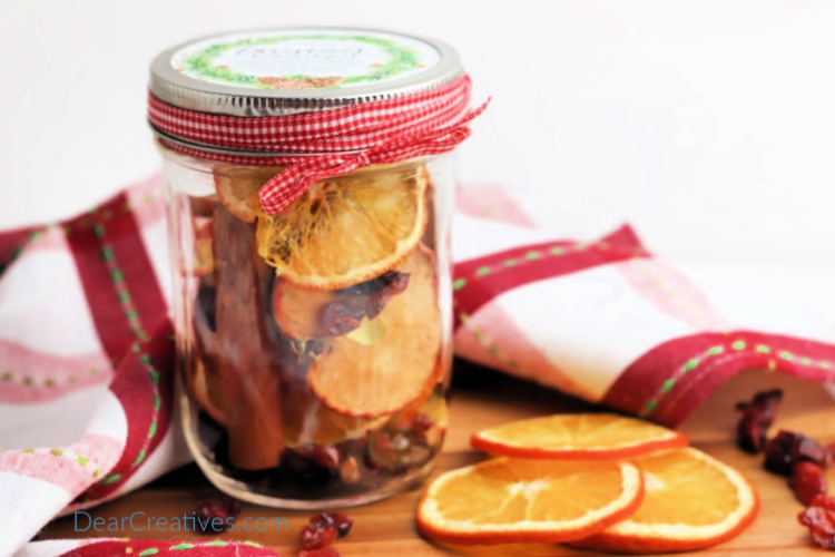 Ribbon added to a jar that has simmering stove top potpourri inside of it. Make this for you or as a gift to make your house smell good. DearCreatives.com