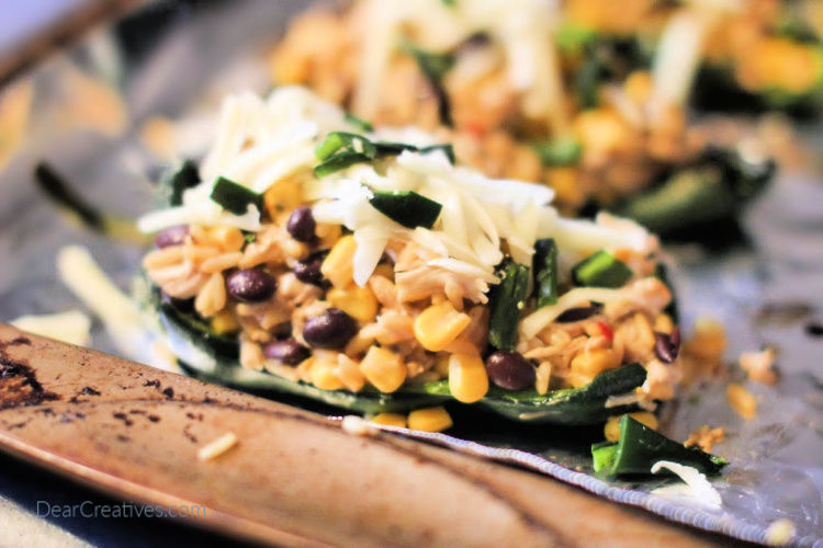 Stuffed Poblano Peppers ready to be cooked on a sheet pan in the oven. Grab the recipe for stuffed peppers at © 2019 DearCreatives.com